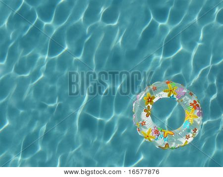Top view of inner tube floating on sunbathed swimming pool - high resolution large file