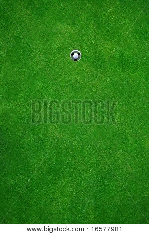 Golfball in golfhole after a perfect put