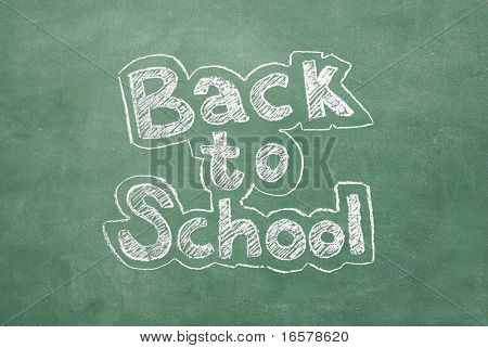 large XXL image of an old chalkboard with the phrase Back to school written on it