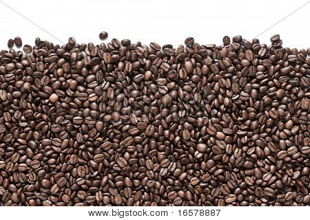Fresh roasted coffee beans ready for the grinder isolated on white background