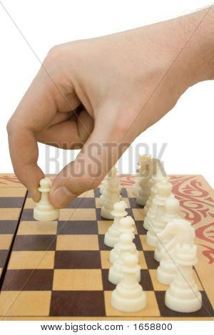 Pawn In Hand And Chessboard