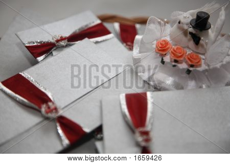 Lots Of Wedding Cards With Red Tie In Basket