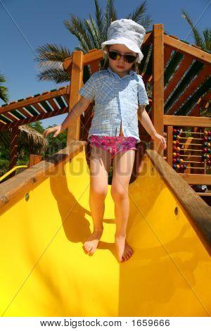 Tropical Girl On Slide