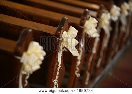 Wedding Decorations On Banches In Church Stock photo