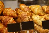 Постер, плакат: Fresh Baked Croissant On Sale In Food Store