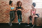 Three Young Friends Talking After Fitness Training poster