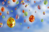 stock photo of easter-eggs  - Many colorful Easter Eggs falling from the sky - JPG