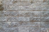 pic of cinder block  - Several rows of a rough textured concrete block wall - JPG