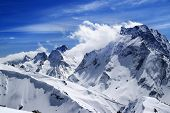 Постер, плакат: Winter Mountains With Snow Cornice And Blue Sky With Clouds In Nice Sun Day