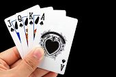 foto of playing card  - hand holding four playing card - JPG