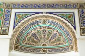 stock photo of concubine  - Morocco Bahia Palace Marrakech lintel carved of stucco in peacock fan traditional design  - JPG