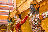 foto of glorify  - Titans and monleys carry golden pagoda decoration in temple of emerald Buddha - JPG