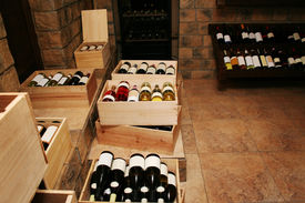 stock photo of wine cellar  - Bottles with old wine in liquor store - JPG