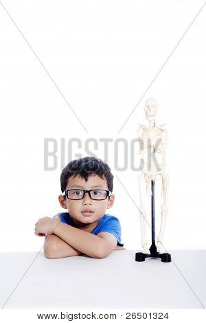 Boy With Human Skeleton Model