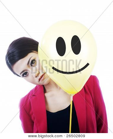 Attractive Sad Businesswoman  Behind A Smiley Face