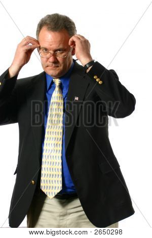 Businessman Putting On His Glasses