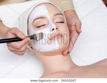Woman Having A Facial Cosmetic Mask