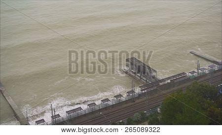 poster of The Raging Black Sea In Sochi Russia. The Sea Is Raging In Sochi. The River Is Mixed With The Sea. S
