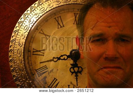 Man'S Face Superimposed On Old Clockface
