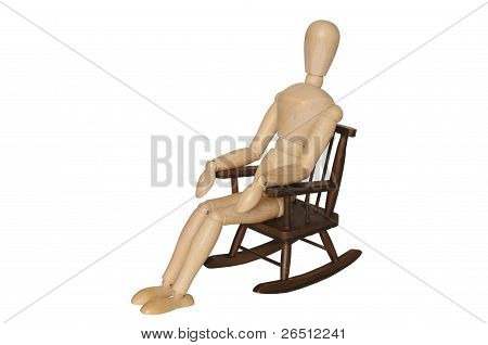 Wooden Dummy Sitting On Armchair