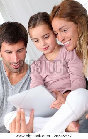 Family using electronic tablet at home