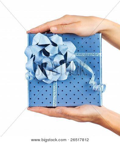 Female Hands Holding Blue Gift Box