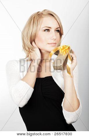 Beautiful Female Holding Gift
