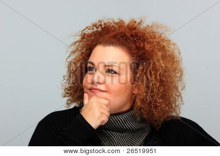 Contrast portrait of beautiful blond plus-size girl making faces