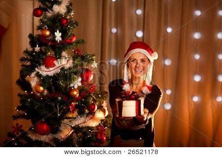 Beautiful Girl Near Christmas Tree Presenting Gift Box