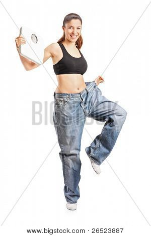 Full length portrait of a weightloss woman holding a weight scale isolated on white background