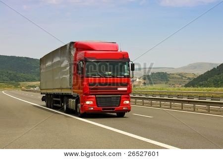 Gilau, Romania - July 20, 2011 - Truck on asphalt road in a summer day