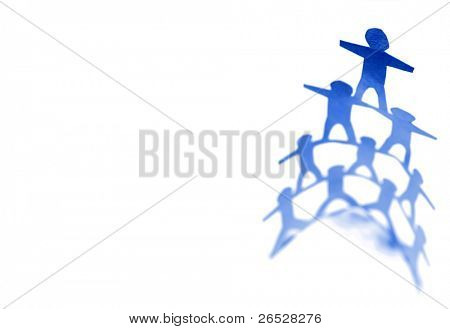 Human pyramid standing on plain background