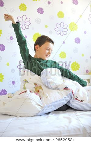 boy awakeing in his bed