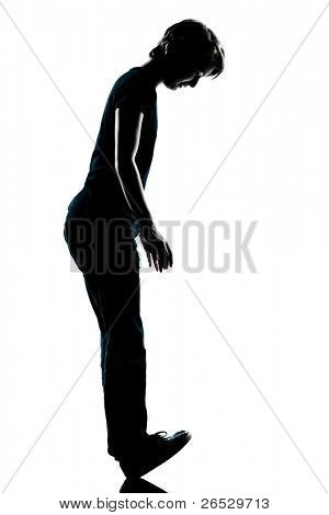 one caucasian young teenager silhouette boy or girl standing balancing on heels full length in studio cut out isolated on white background