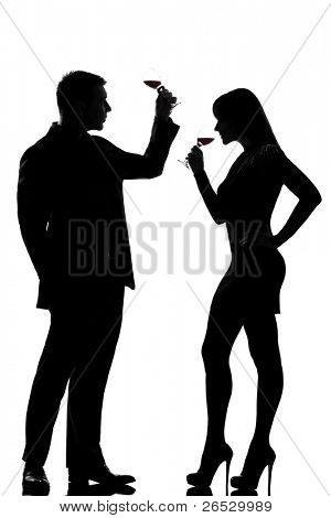 one caucasian couple man and woman drinking red wine tasting  in studio silhouette isolated on white background