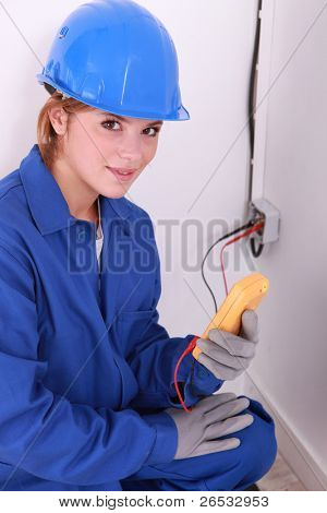 Woman taking electrical reading