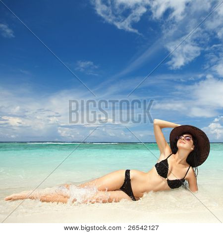 Happy fashion woman rest on the beach