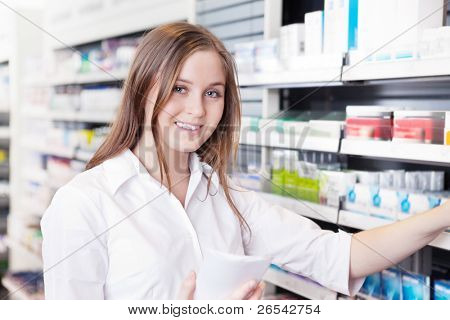 Portrait of female pharmacist working in pharmacy drugstore