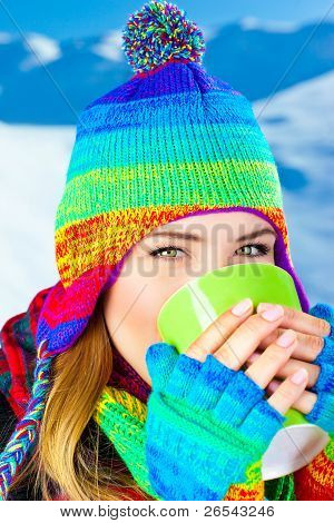 Beautiful Girl Drinking Hot Chocolate Outdoor In Winter
