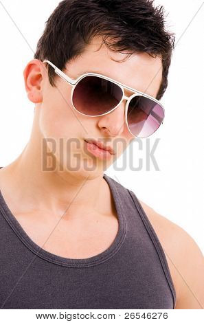 Portrait of stylished young man wearing sunglasses on white background