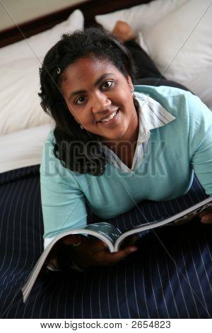 Woman Reads Magazine