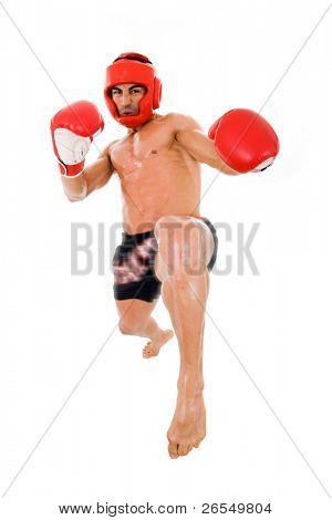 Young Boxer fighter making a kick over white background