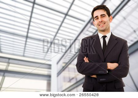 Portrait of an handsome smiling businessman at a modern office bulding