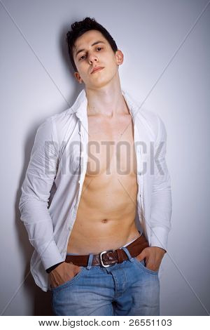 Style photo of a young man posing against grey background