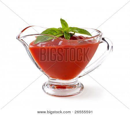 tomato sauce with basil leaf on a white backgroundand with soft shadow