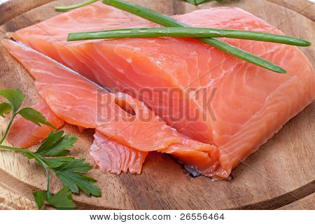 salmon pieces on a chopping board