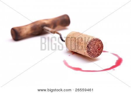 Corks and red wine stain over white background