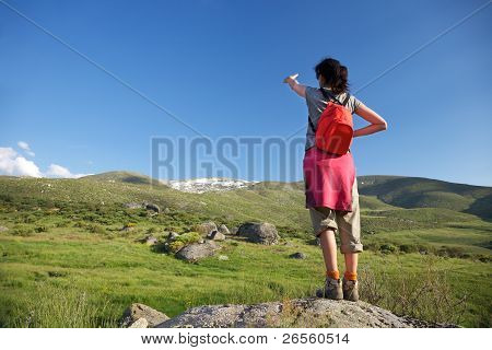 Red Rucksack Woman Pointing Gredos Mountain