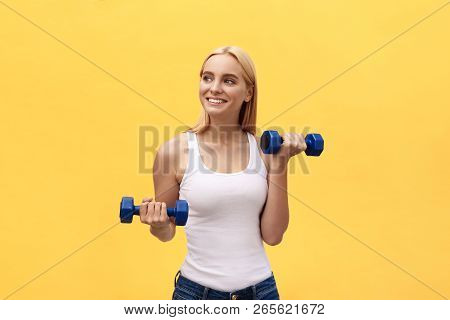 poster of Fitness Woman Lifting Weights Smiling Happy Isolated On Yellow Background. Fit Sporty Caucasian Fema