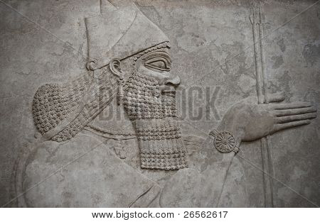 Head of an ancient assyrian warrior carved in stone